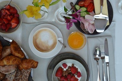 Crunchy cardamon scented granola, fres berries, fresh buttery croissants and pain au chocolate. Omelettes and smoked salmon or bacon. Anything really. With freely squeezed orange juice and coffee.